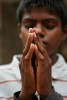 Thirteen-year-old John Peter says his evening prayer before eating dinner. {quote}We do not convert here. We have Christians, Hindus and Muslims,{quote} said John Kennedy Samson, Morning Star's director.