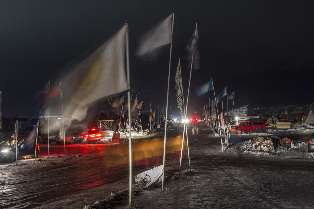 Flag Road served as the entrance and main thoroughfare for the Oceti Sakowin camp at Standing Rock. At night the camp took on a surreal, haunting feeling.