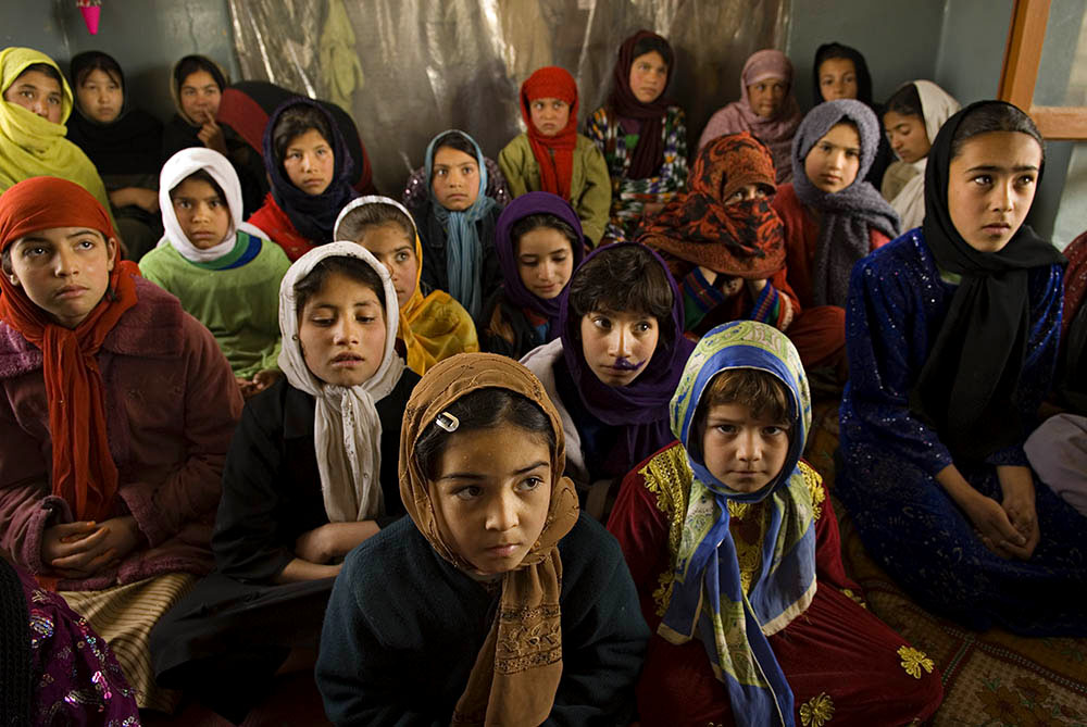 A girls' class at the AWEC Khair Khana Center, which provides training, education, and support to street children. Classes are segragated by gender.U.N. estimates place the number of street children in Kabul at approximately 50,000 to 60,000.