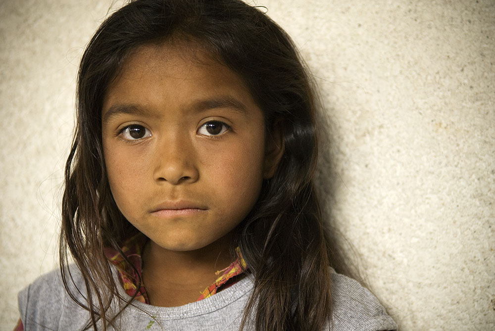 A young girl attends a Mexfam community health promoter's presentation on family planning in a small colonia on the outskirts of Tepeji del Rio.