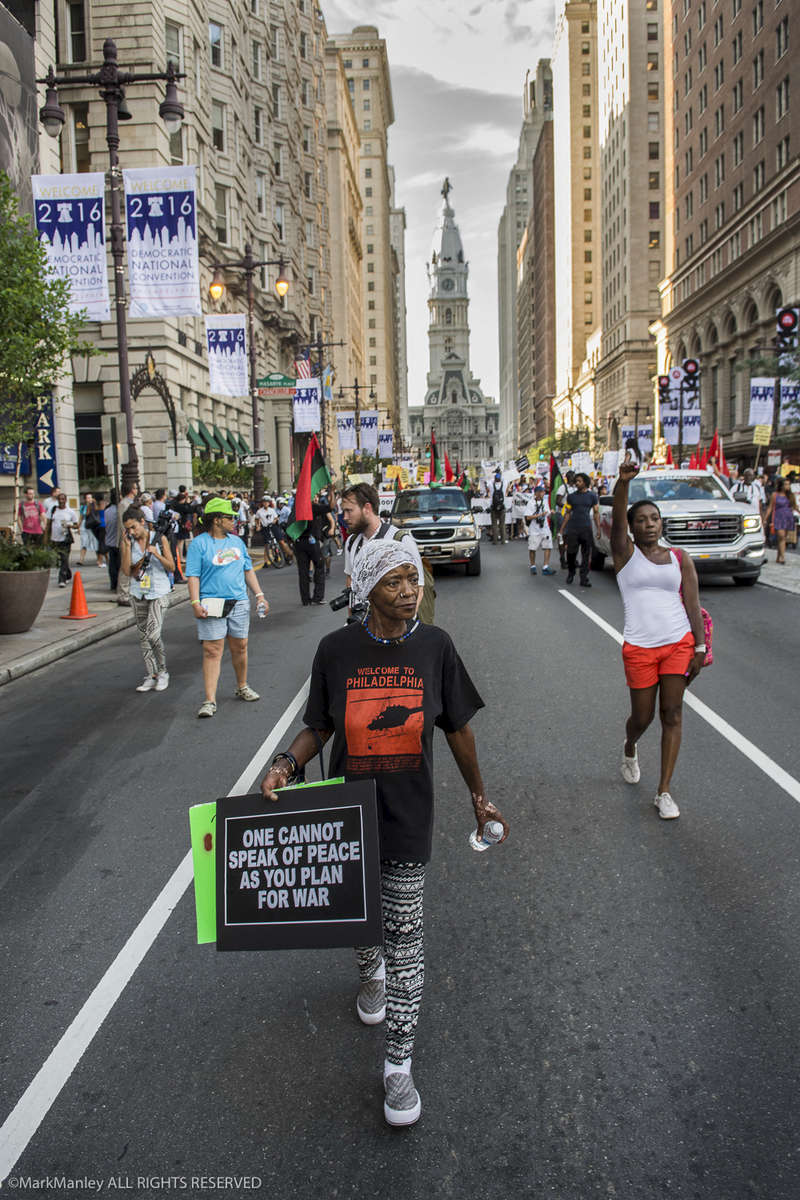 Marchers head north on Broad Street towards the Wells Fargo Arena during the Black Lives Matter march at the DNC in Philadelphia.