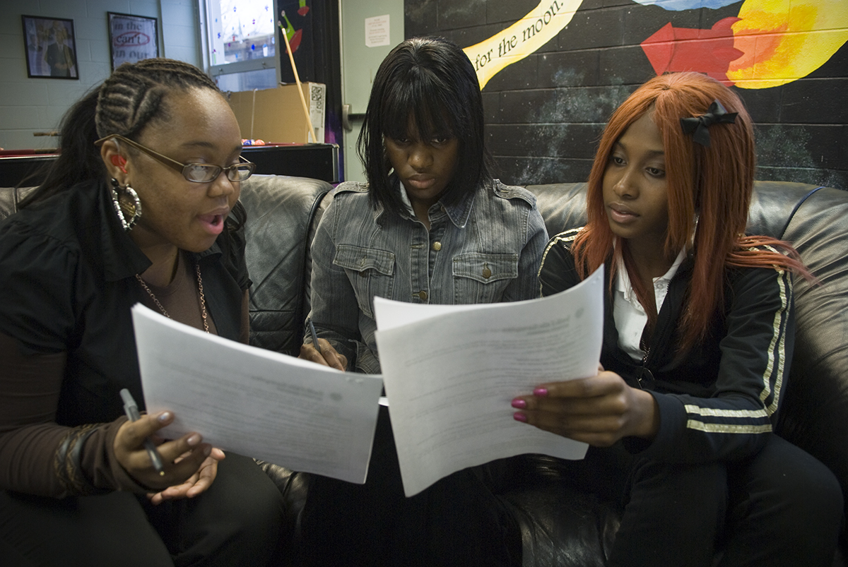 Ladawna Robinson (center) iis engaged with her peers during an {quote}Ice Breaker{quote} activity. The activity was part of a girls empowerment group session at The Space at Orange High School