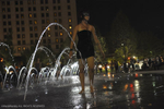 A young woman relaxes in a fountain at Public Square in Cleveland during the RNC.