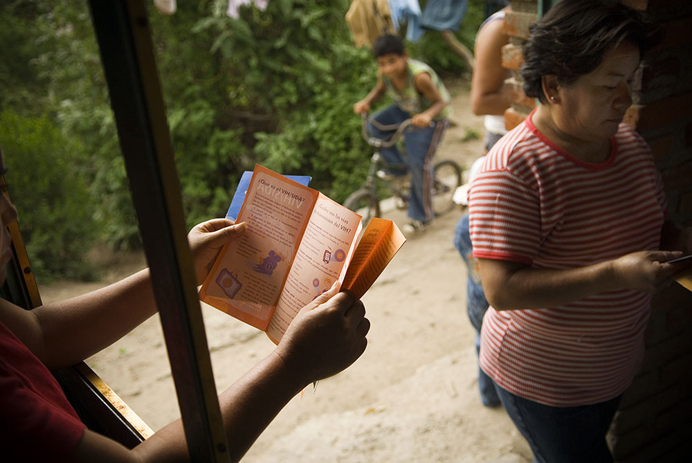 Women read Mexfam educational materials prior to the start of a community presentation by the local health promoter in a small village outside Tepeji del Rio, about two hours' drive southeast of Mexico City.The Rural Communities Program delivers health services in marginalized rural communities such as this one. Utilizing local volunteers as trained health promoters to provide health education, intervention where appropriate, and assessment and referral, the program provides vital medical education and triage to communities that often have little or no other health care alternatives.