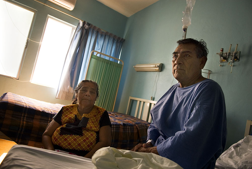 A patient waits with his wife prior to surgery at the clinic in Ixtaltepec. In addition to providing sexual and reproductive health services, Mexfam clinics and rural and urban community programs provide a wide range of medical services to in-need and underserved populations.
