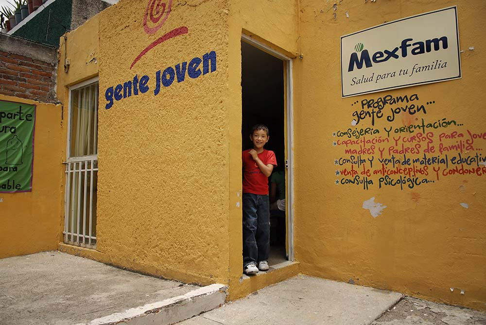 The Gente Joven Center in San Juan Rio Mexico. The Gente Joven {quote}young people's{quote} program is Mexfam's unique attempt to address sexual health service and information needs of young people in Mexico. Using adolescent {quote}peer{quote} health promoters, it is a national program that targets youth ages 10 to 25 from urban and rural marginalized areas across the country. In addition to doing formal presentations in schools and recreation centers, peer promoters do active outreach engaging young people in the streets, schools, sports and recreation centers, workplaces and other places where young people usually gather.Through this program, Mexfam hopes to meet Mexican youths' sexual and reproductive education needs while shaping a new youth sexual health culture that considers sexual education and information for adolescents and young people, as well as the corresponding comprehensive youth friendly services, a social obligation.
