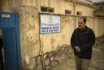 Hakim Ahmadyaar, stands outside the AWEC Center where he works as a Social Worker.
