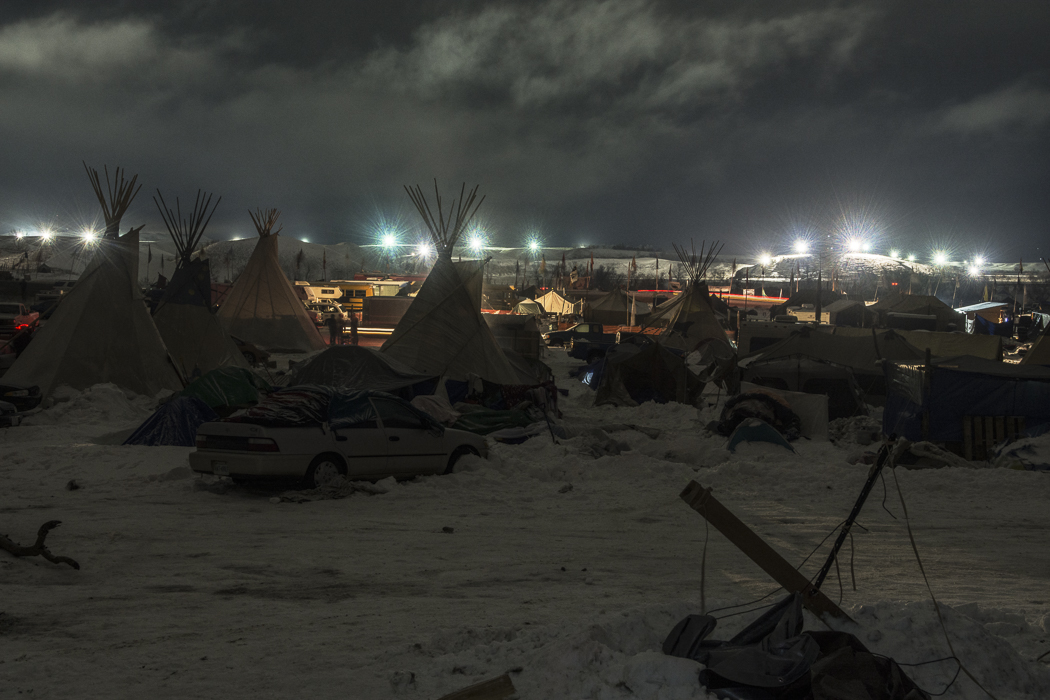 DAPL floodlights line the north end of the Oceti Sakowin camp at Standing Rock, N.D.