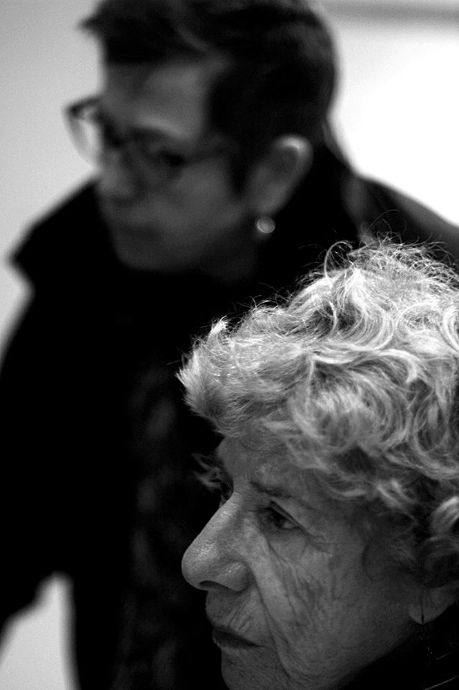 Arlene Ellner ( foreground ) and Diane Dryfeus GAW members, confer prior to the weekly vigil.