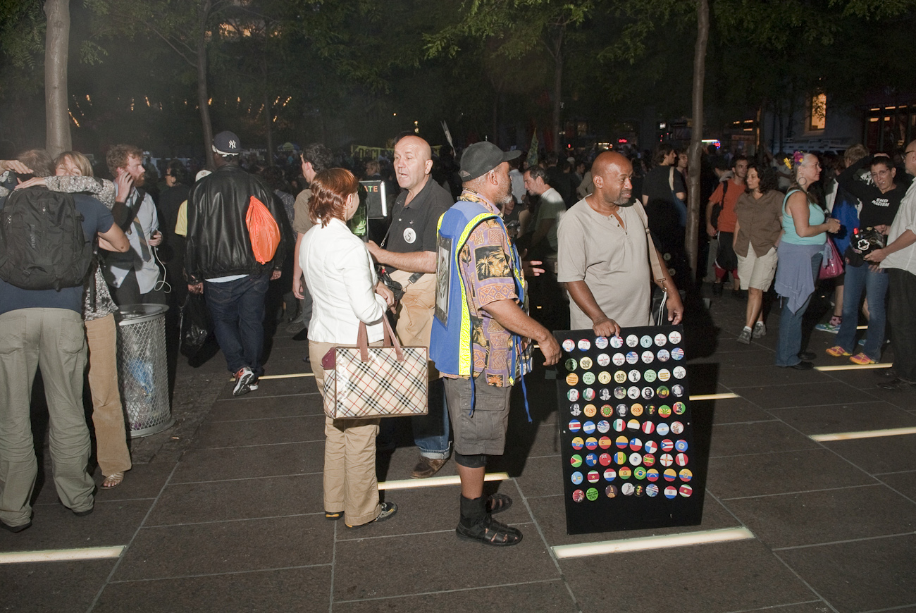 A man sells political buttons inside Liberty Square (Zucotti park)  during the Popular Assembly held there to commemorate the first anniversary of the Occupy Wall Street movement.