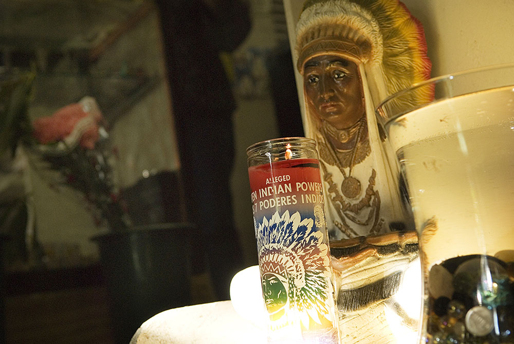 An altar and offerings inside Botanica Santa Rosa. Native American imagery is sometimes incorporated into Santeria rituals.