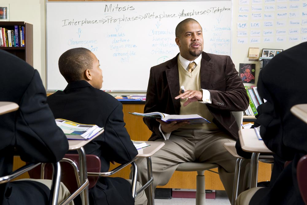 Mr. Childress in the classroom with his students.  I photographed many aspects of the school life at Urban Prep Academy  which is the first chartered {quote}all-boys{quote} school in the Chicago Public School District.  The photos were commissioned for use in their printed materials and their website, including the dissolve affect on their splash page.