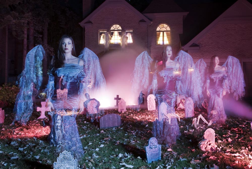 Michelle Allison, dressed up as a death angel infront of her Glenview home.  Part of a feature story on extravagantly decorated homes for Halloween.