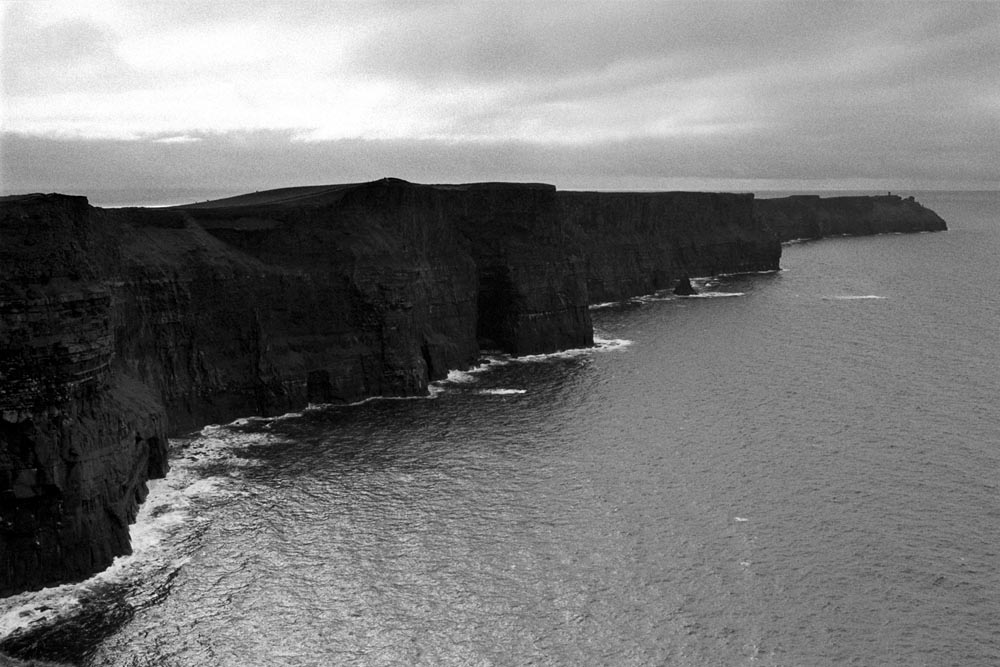 The Cliffs of Moher (Irish: Aillte an Mhothair, lit. cliffs of ruin).  Located at the southwestern edge of the Burren near the town of Doolin.