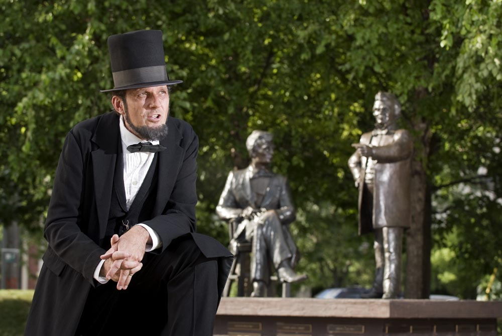George Buss, a Freeport, Illinois school administrator, moonlights as one of the nation's most accomplished Lincoln interpreters.  The statue is in Freeport, Illinois and commemorates one of the actual sites where the Lincoln Douglas debates occured.  The article detailed the 150th anniversary of the debates.