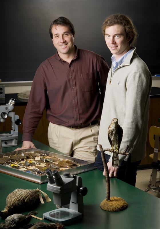 Professor and student in the biology lab.