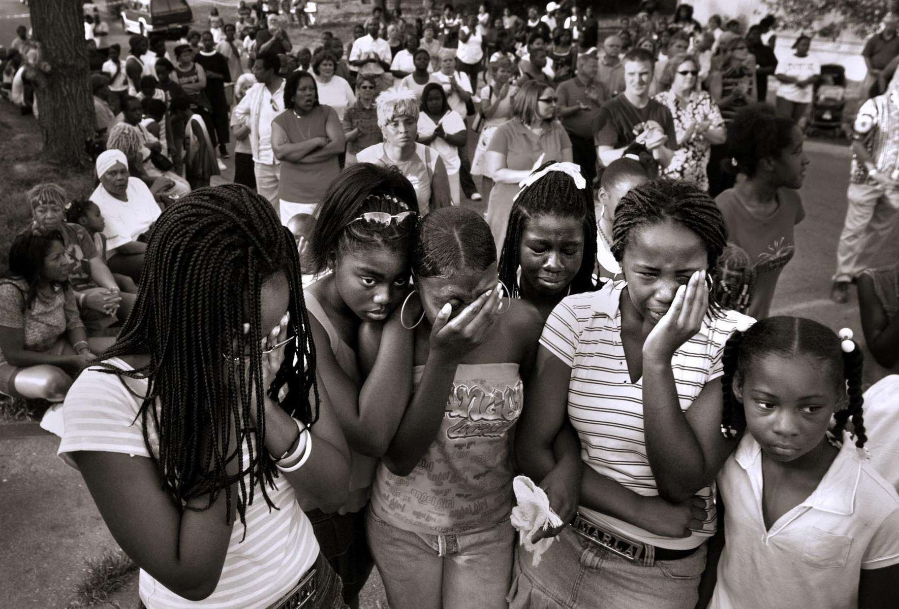 "Leighann Johnson, left, Shonnie Branom, Judeia Jones, Sanosa Berry, Marla Johnson and Aaliyah Hawkins morn Joseph ""Bam Bam"" Long during a community prayer service for Long, slain police Sgt. William McEntee, and McEntee's accused murderer Kevin Johnson in Kirkwood, Mo..  Johnson shot McEntee after an early incident in the nighborhood during which {quote}Bam Bam{quote} collapsed and died from a heart condition.  About 800 people gathered at the intersection of Alsobrook and Orleans streets on Saturday.  After praying at the intersection the group marched up to the site where the officer was shot and then over to the memorial outside of Long's house."