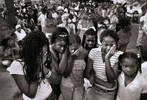 """Leighann Johnson, left, Shonnie Branom, Judeia Jones, Sanosa Berry, Marla Johnson and Aaliyah Hawkins morn Joseph """"Bam Bam"""" Long during a community prayer service for Long, slain police Sgt. William McEntee, and McEntee's accused murderer Kevin Johnson in Kirkwood, Mo..  Johnson shot McEntee after an early incident in the nighborhood during which {quote}Bam Bam{quote} collapsed and died from a heart condition.  About 800 people gathered at the intersection of Alsobrook and Orleans streets on Saturday.  After praying at the intersection the group marched up to the site where the officer was shot and then over to the memorial outside of Long's house."""