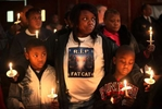 Byron Blassingame Jr., left, and Darrion Bassingame Jr., right, are comforted by their grandmother Jacqueline Heard, center, as the names of the 145 murder victims from the city of St. Louis are read aloud during the 18th Annual Families Advocating Safe Streets candle light service to remember 2009's murder victims at El Bethel Church of God in Christ on Thursday in St. Louis.  Heard's son Byron Blassingame Sr. was shot and killed along with two other men in the same SUV as they were waiting at stop light near Union Station on May 8, 2009.  Byron Jr. was Byron Blassingame Sr.'s son and Darrion Blassingame Jr. was his nephew.