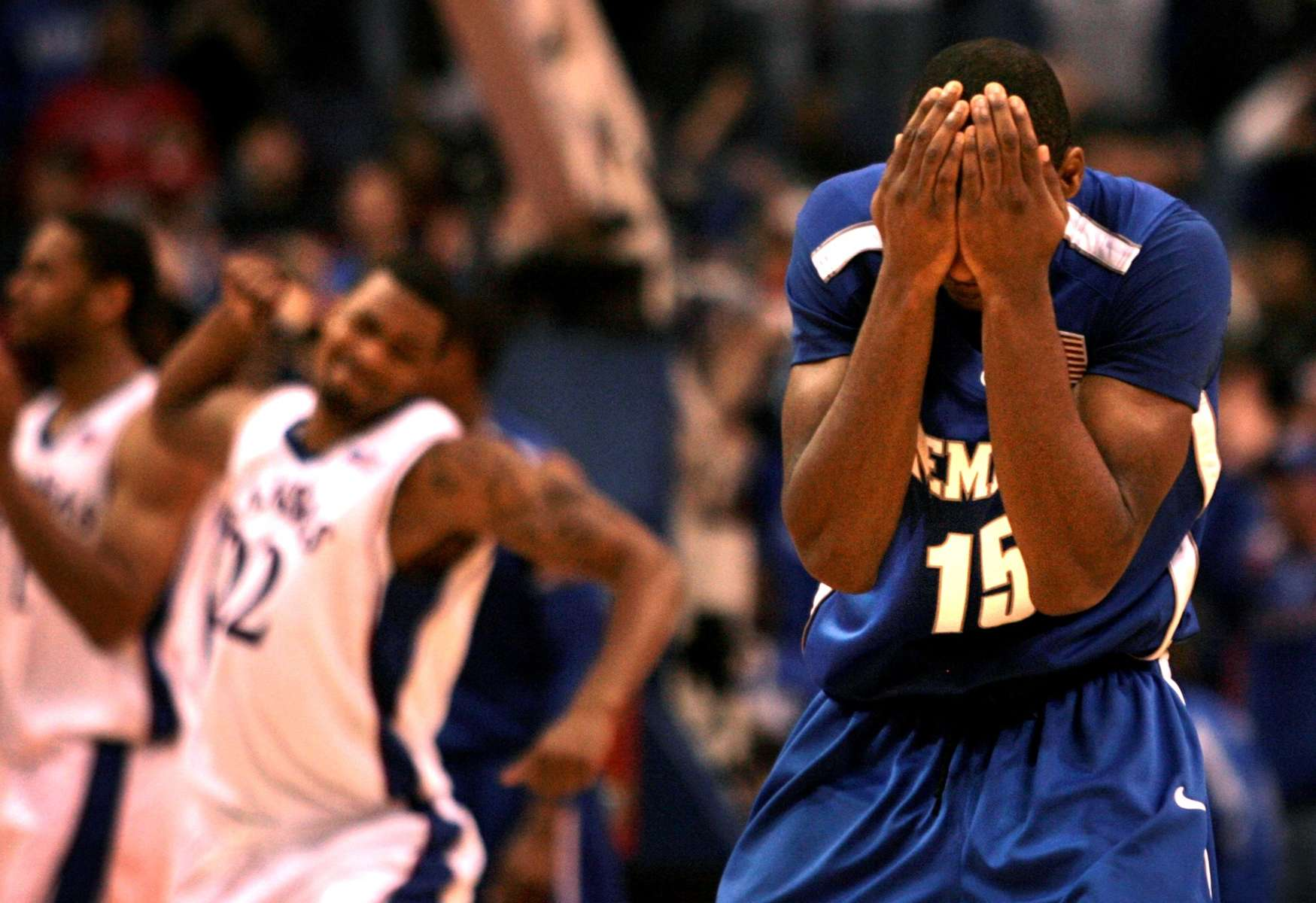 Memphis's Elliot Williams holds his head in frustration after missing the potential game winning shot at the end of the game between the Memphis Tigers and Kansas Jayhawks at the Basketball Hall of Fame Classic in the Scottrade Center in St. Louis, Mo. Tuesday November 17, 2009.
