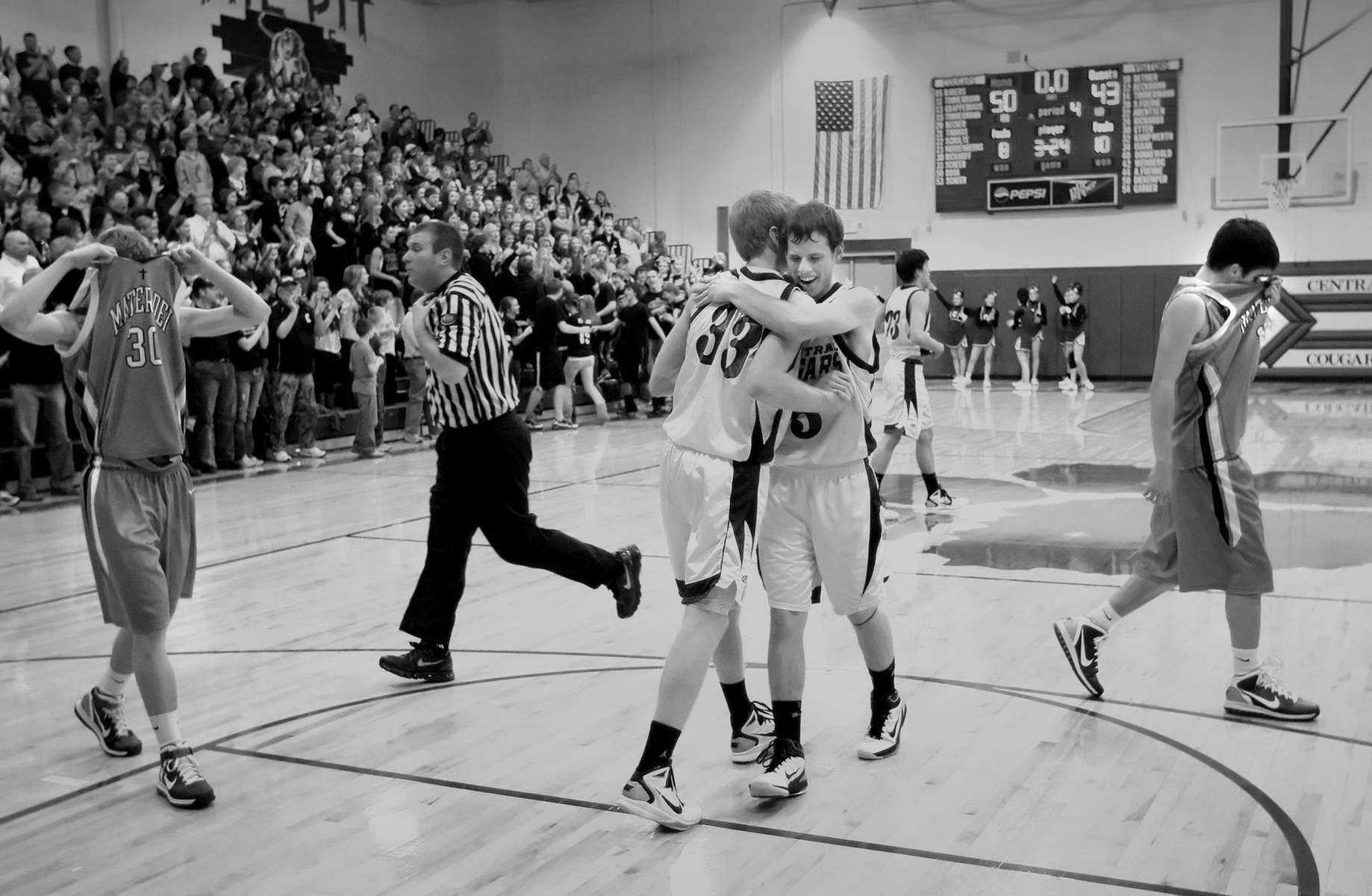 Friday February 11, 2011--Breese Central's Keaton Scheer, center left, and Brandon Rakers, center right, celebrate after the final buzzer of the Breese Central Mater Dei boys basketball ball game at Central on Friday.  Breese Central defeated Mater Dei 50-43.David Carson     dcarson@post-dispatch.com