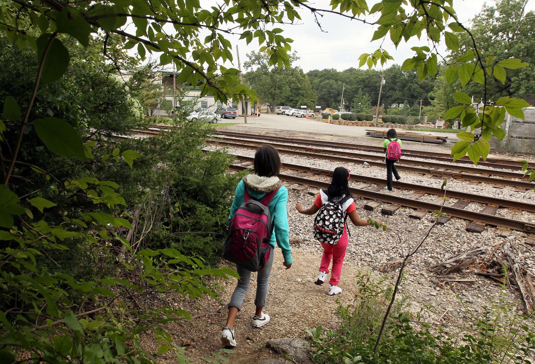 Middle School students from Nipher Middle School in Kirkwood walk a well worn path that leads them across a set of railroad tracks on their way home after school on Friday, Sept. 14, 2012.  Everyday more than a dozen students take the same path across the tracks as they walk both to and from school. Photo By David Carson, dcarson@post-dispatch.com