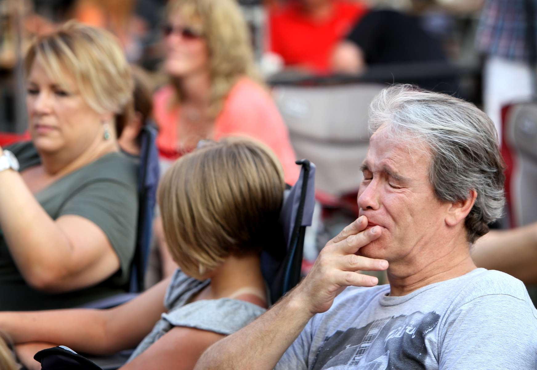 Darryl Vennard (right) holds back tears as he listens to his son Ben Vennard playing {quote}While My Guitar Gently Weeps{quote} in a tribute Cam Vennard, Darryl's son and Ben's brother, during memorial concert in Cam's honor on July 12, 2012 in Kirkwood.  Cam, 14, was walking along the tracks east of downtown Kirkwood when he was struck and killed by westbound train in May of 2012.Photo By David Carson, dcarson@post-dispatch.com