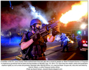 A member of the St. Louis County Police tactical team fires tear gas into a crowd of people on West Florissant Avenue in Ferguson in response to gunshots fired at police during protests on Monday, Aug. 18, 2014. For more than two weeks, police and protesters clashed nightly as civil unrest and protests exploded after Michael Brown, an unarmed black 18-year-old, was shot and killed by Darren Wilson, a white Ferguson police officer.Photo by David Carson, dcarson@post-dispatch.com
