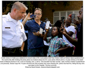 J'vonte Jones, 8, holds up a cellphone to record video of St. Louis police chief Sam Dotson (left) as Dotson takes questions from the community after briefing the press about an incident where two St. Louis police officers shot a 14-year-old boy in the 5000 block of Beacon Avenue in St. Louis on Sunday, Oct. 2, 2016. {quote}This shouldn't be their normal,{quote} said J'vonte's mother Crystal Brown (not pictured). Dotson says the 14-year-old fired one shot at police who were chasing him, police returned fire, hitting the boy who was taken to the hospital. The boy survived.Photo by David Carson, dcarson@post-dispatch.com