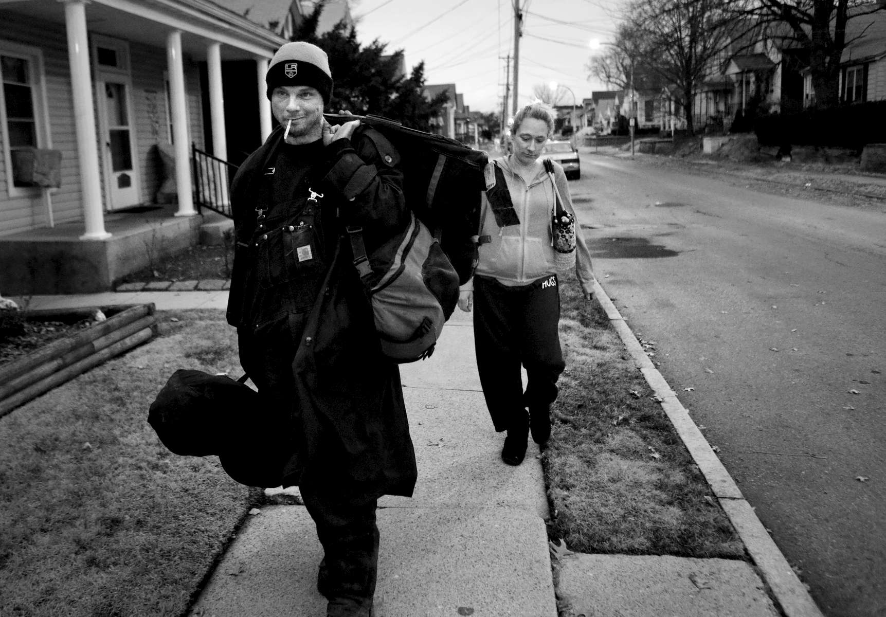 Richard Skinner and Ashley Johnston walk to Johnston's home to wash his clothes and shoot heroin in St. Louis on Monday, Feb. 6, 2017. Johnston and Skinner have a 12-year-old child together that is cared for by Johnston's mother. The two are still attracted to each other but Johnston is currently six months pregnant with another man's child.