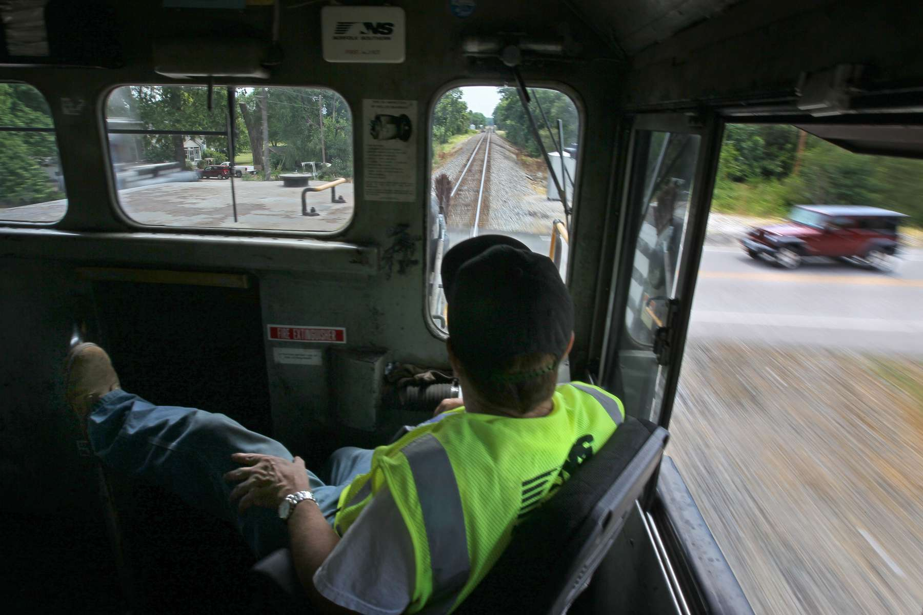 Conductor Doug Lanier keeps an eye out the front window of a train as it rolls through a street crossing in O'Fallon, Mo. on Wednesday July 11, 2012.  The train ride Lanier was on was part of training ride for police officers taking part in an Operation Lifesaver training session.  Photo By David Carson, dcarson@post-dispatch.com