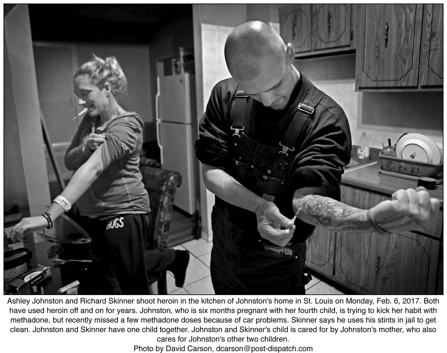 Ashley Johnston and Richard Skinner shoot heroin in the kitchen of Johnston's home in St. Louis on Monday, Feb. 6, 2017. Both have used heroin off and on for years. Johnston, who is six months pregnant with her fourth child, is trying to kick her habit with methadone, but recently missed a few methadone doses because of car problems. Skinner says he uses his stints in jail to get clean. Johnston and Skinner have one child together. Johnston and Skinner's child is cared for by Johnston's mother, who also cares for Johnston's other two children.Photo by David Carson, dcarson@post-dispatch.com