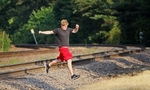 Austin Huster, 16, crosses the train tracks near where Cam Vennard, 14, was killed by a train on his way to a memorial concert, Cam Jam, in Cam's honor on July 12, 2012 in Kirkwood.  Cam, 14, was walking along the tracks east of downtown Kirkwood when he was struck and killed by westbound train in May of 2012.  After crossing the tracks Huster and a friend stopped by a make shift memorial for Cam and then continued walking to the concert.Photo By David Carson, dcarson@post-dispatch.com