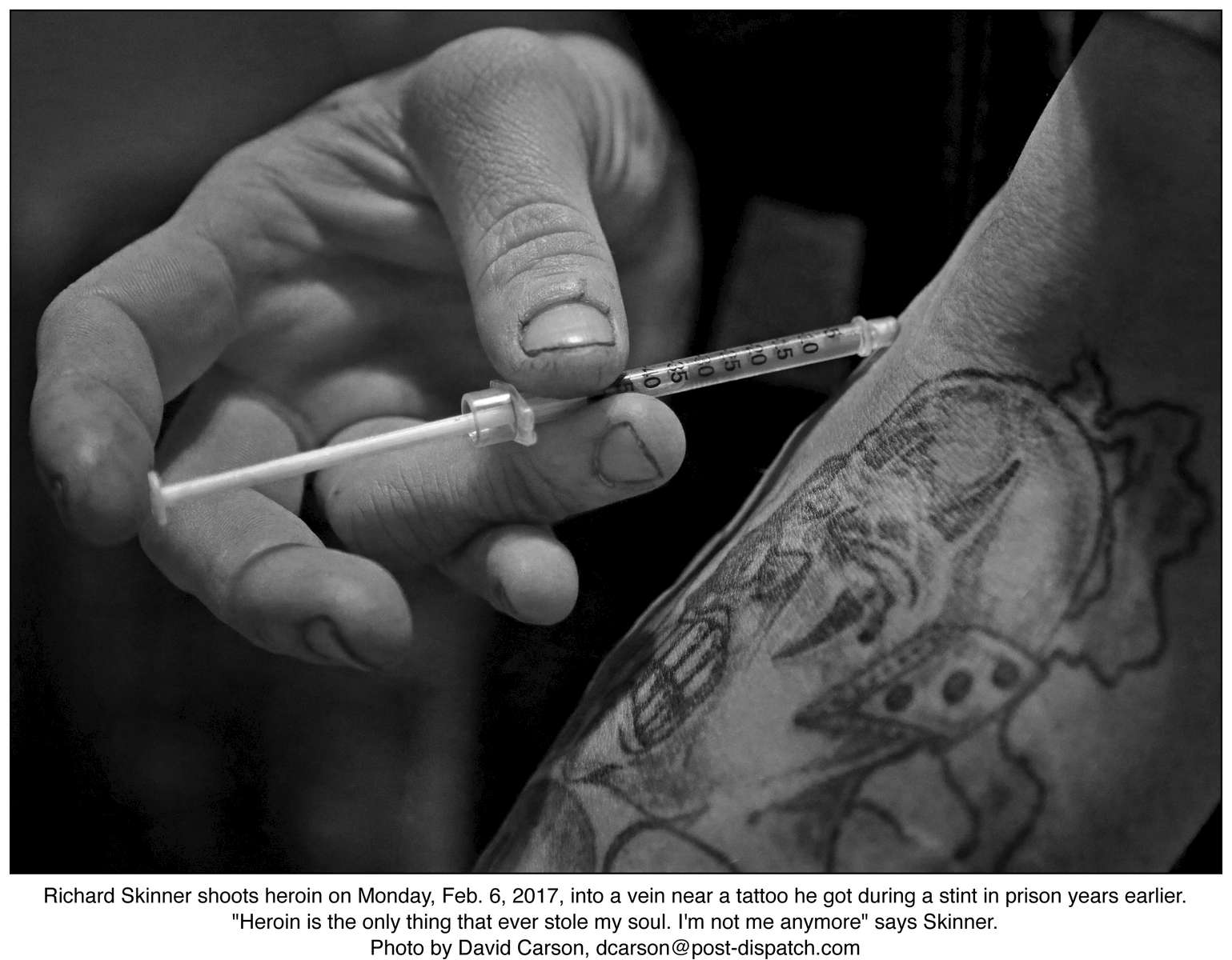 Richard Skinner shoots heroin on Monday, Feb. 6, 2017, into a vein near a tattoo he got during a stint in prison years earlier.  {quote}Heroin is the only thing that ever stole my soul. I'm not me anymore{quote} says Skinner.Photo by David Carson, dcarson@post-dispatch.com