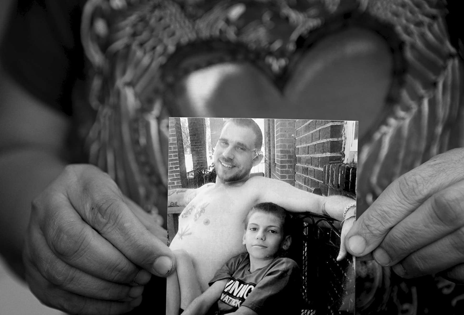 Maria Torres, 44, holds a picture on Monday, Feb. 6, 2017 of her deceased husband Allen Goins who died of acute fentanyl intoxication on in February of 2016. Goins was one of more than 270 fatal opioid overdoses that happened in the city of St. Louis in 2016. The boy pictured with Goins is Dominic Torres, the son of Maria and Goins.
