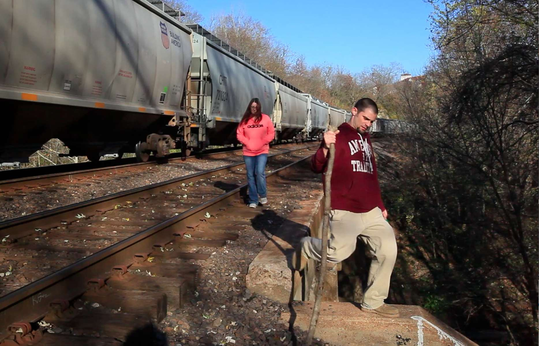 A pair of pedestrians walk across a train trestle with a stopped train on it in Castlewood State Park in St. Louis County on Thursday, Nov. 8, 2012.  The trestle was the site of accident in 1999 involving a mother, Jessica Blair, who was killed and her four year-old son, Dillion Blair who was injured.   The couple did not want to be identified.Photo By David Carson, dcarson@post-dispatch.com