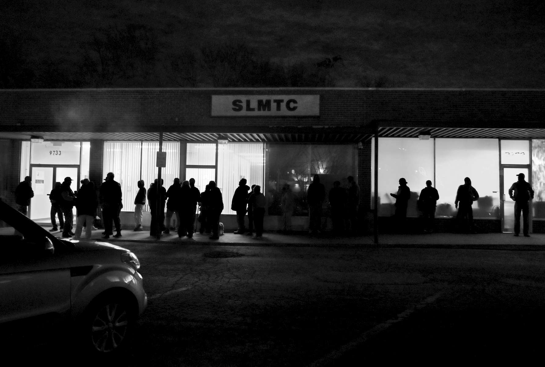 People line up outside the St. Louis Metro Treatment Center at 5 a.m. to get their daily dose of methadone on Monday, April 3, 2017. The clinic opens it's doors to clients at 5:15 am, many in line come early because they need to their dose before going to work for the day.