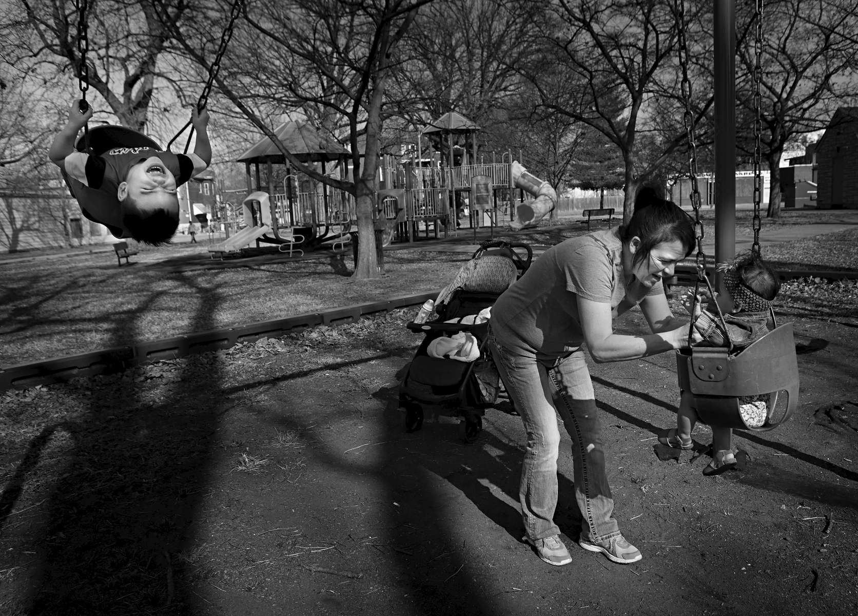 Travis Garner, 3, goes high on the swings as his aunt Josie Martinez prepares to give Travis's sister Amya Garner, 8 months, a push at South St. Louis Square Park in St. Louis on Tuesday, Feb. 7, 2017. Martinez takes the children to the park often but makes Travis wait on a bench until she makes sure the playground is free of dirty syringes.