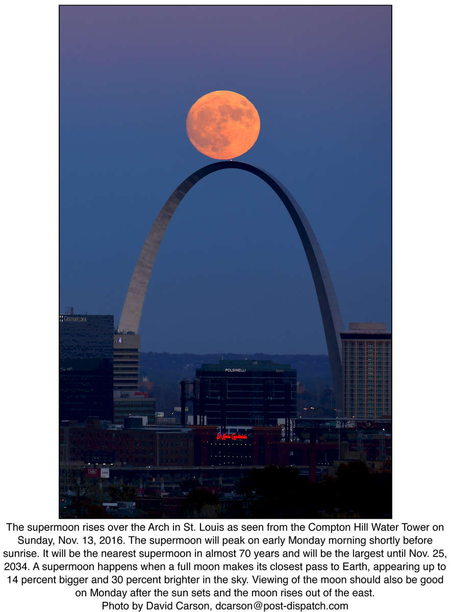 The supermoon rises over the Arch in St. Louis as seen from the Compton Hill Water Tower on Sunday, Nov. 13, 2016. The supermoon will peak on early Monday morning shortly before sunrise. It will be the nearest supermoon in almost 70 years and will be the largest until Nov. 25, 2034. A supermoon happens when a full moon makes its closest pass to Earth, appearing up to 14 percent bigger and 30 percent brighter in the sky. Viewing of the moon should also be good on Monday after the sun sets and the moon rises out of the east. Photo by David Carson, dcarson@post-dispatch.com