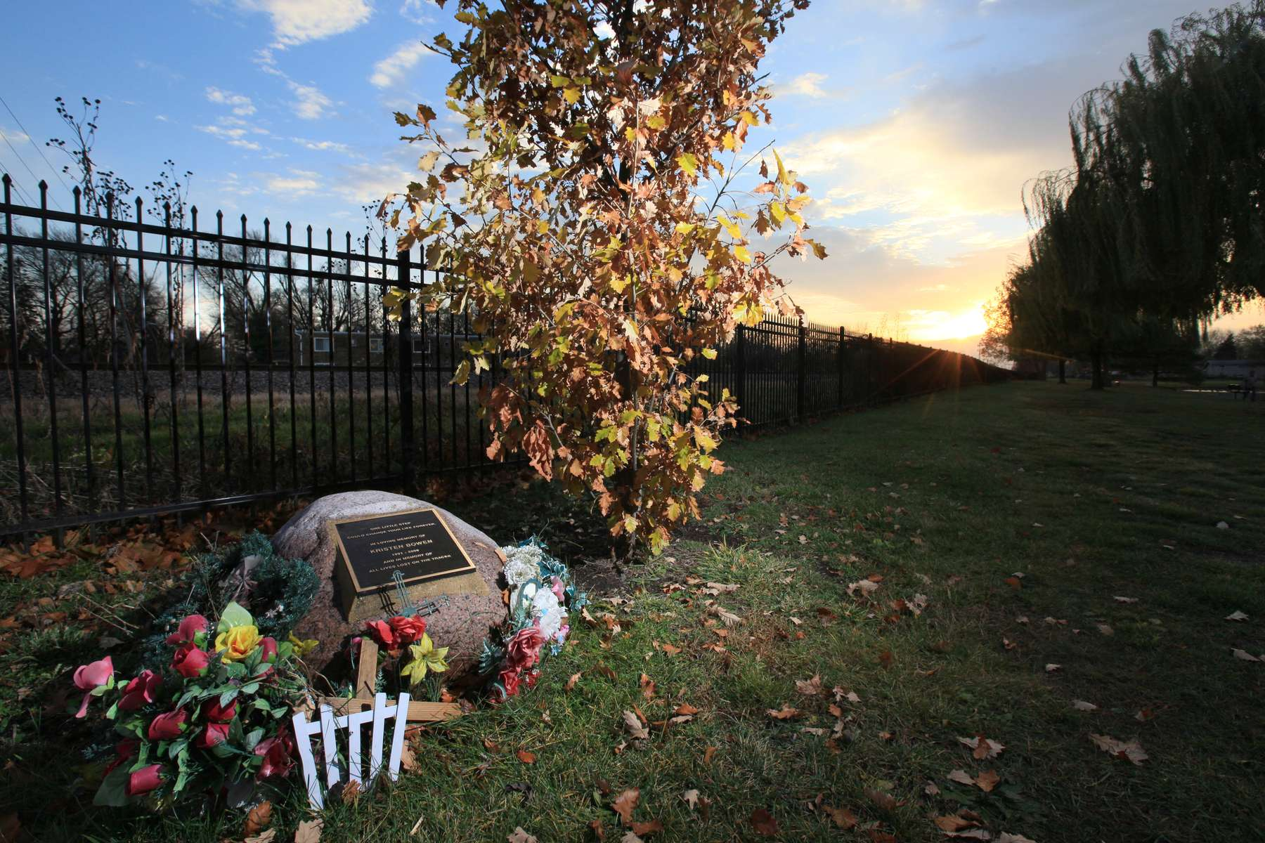 A memorial for Kristen Bowen, who was struck and killed by a train as she crossed the tracks walking from her home to this park in Villa Park, Ill. in 2006, sits beside a fence that now stands between the park and the tracks.  Bowen's death was used to rally the support of local residents to put up fences along train tracks in the city.Photo By David Carson, dcarson@post-dispatch.com