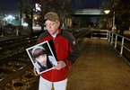 Walter Gaffney holds a picture of his 17-year-old daughter Mary Gaffney on Wednesday, Nov. 28, 2012, along the set of tracks where she was hit and killed by a train in Riverdale Park, Md..  Mary Gaffney and two other people were killed by trains the same day as 14-year-old Cam Vennard, from Kirkwood, was stuck and killed by a train.  Photo By David Carson, dcarson@post-dispatch.com
