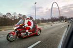 Danny Wall, from Fenton, cruises down Interstate 70 West through downtown St. Louis on his way to deliver a present to a three-year-old boy in Granite City on Tuesday, Dec. 3, 2013.  {quote}I love seeing the expression of joy on people's faces as I drive by{quote} said Wall who started playing the role of Santa Claus eight years ago when his first grandchildren were born.  At first he visited just the homes of friends and family but he has visited with groups Boy Scouts, Girl Scouts, and children at Rankin Jordan.  He says playing Santa Claus helps him get the Christmas spirit and relieve stress.  Wall is a riding a 2008 Honda Goldwing Trike.Photo By David Carson, dcarson@post-dispatch.com