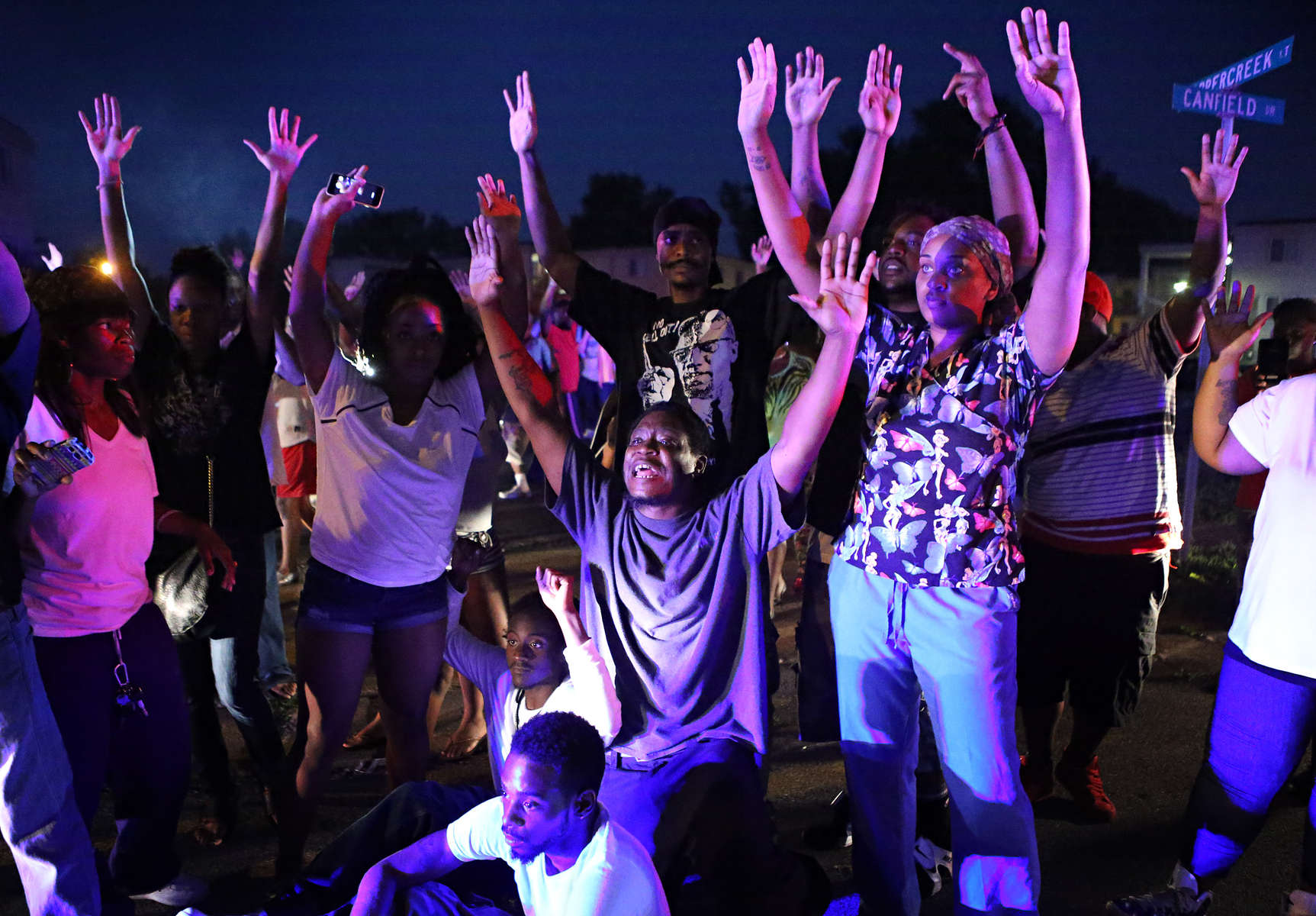 {quote}Don't shoot us{quote} cries out the crowd as they confront police officers arriving to break up a crowd on Canfield Dr. in Ferguson, Mo. on Saturday, Aug. 9, 2014. Earlier in the day police had shot and killed Michael Brown, an unarmed18 year-old man, and community members turned out large numbers at the scene to express their outrage.