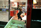 A looter takes items from inside the QuikTrip in 9400 block of W. Florissant Avenue in Ferguson, Mo. on Sunday, Aug. 10, 2014. Rioters set fire to the store about an hour later.