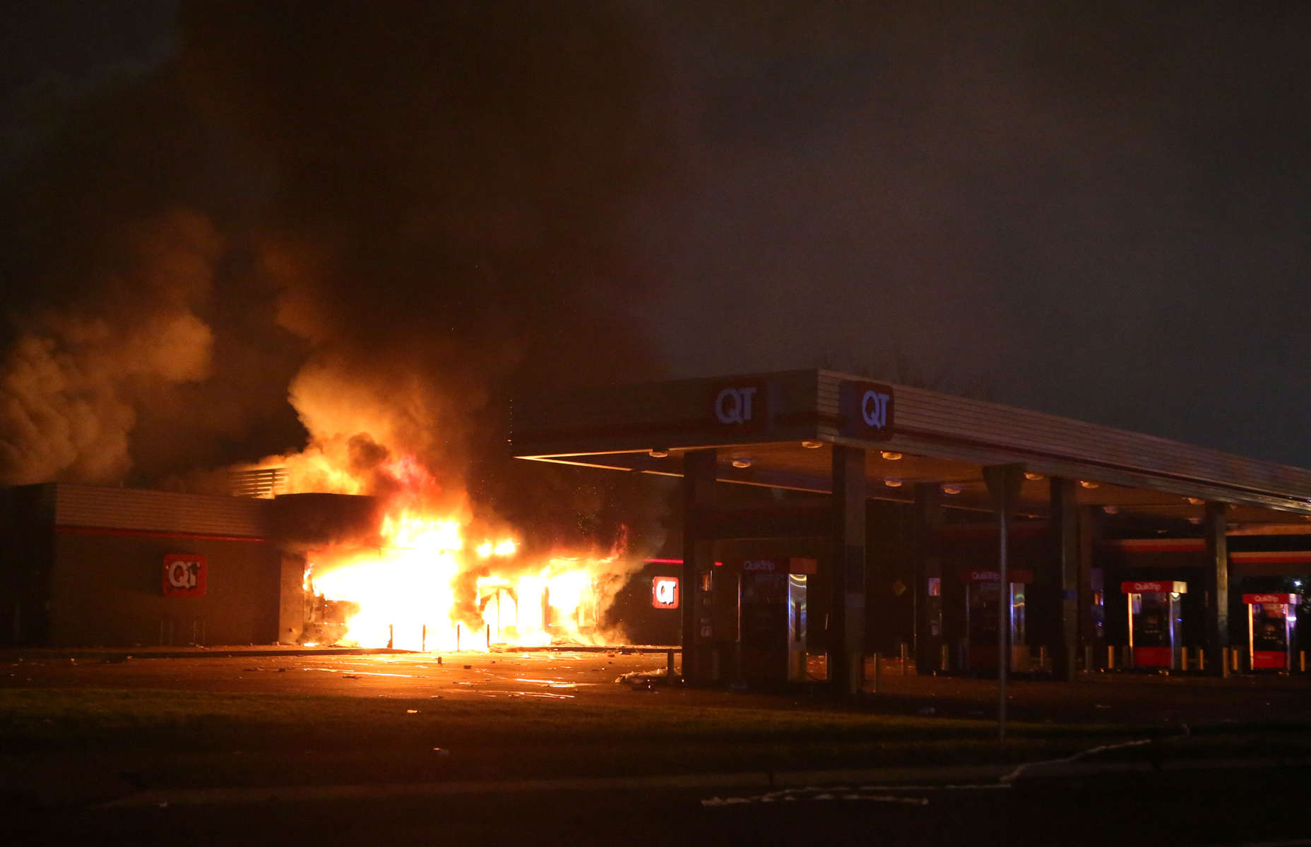 The QuikTrip in 9400 block of W. Florissant Avenue in Ferguson, Mo. burns after being looted by rioters on Sunday, Aug. 10, 2014.  The looting and riots began after a candlelight vigil for Michael Brown when confrontions between police and protesters spiraled out of control.
