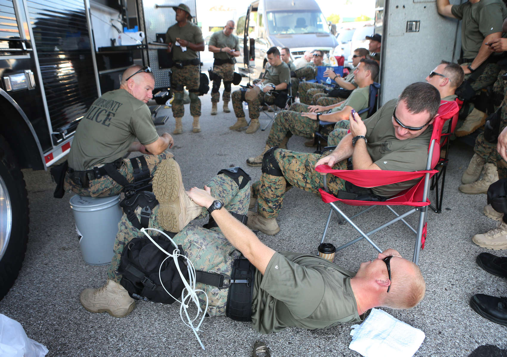 Members of the St. Louis County Police tactical team watch movies at the command center as they wait for a call to help deal with crowds of people along W. Florissant Road in Ferguson, Mo. on Monday, Aug. 18, 2014.Photo By David Carson, dcarson@post-dispatch.com
