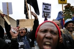 People chant before the start Ferguson October march in downtown St. Louis on Saturday, October, 11, 2014.  Thousands of people took part in the march down Market Street and rally in Kiener Plaza.