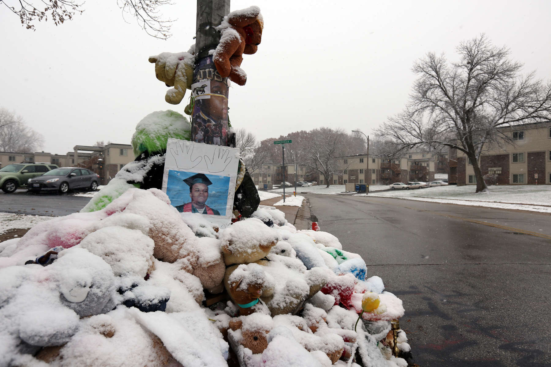 Snow falls on Michael Brown's memorial on Canfield Drive in Ferguson on Sunday, Nov. 16, 2014.  It has been 100 days since Michael Brown was shot and killed by a police officer on Aug. 9th.Photo By David Carson, dcarson@post-dispatch.com
