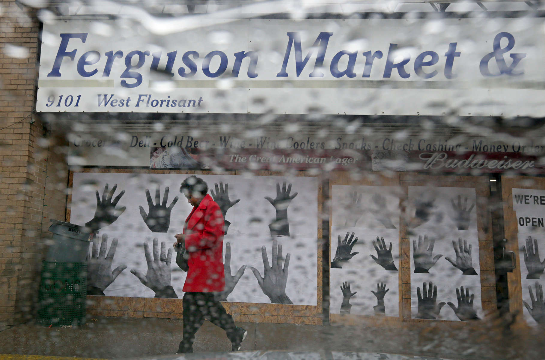 Lisa Johnson, 49, from Northwoods, walks out of the Ferguson Market & Liquor store on West Florissant Avenue in Ferguson on Sunday, Nov. 23, 2014.  {quote}They're not going to make the right decision{quote} said Johnson expressing concern about the grand jury's decision that is expected to be released any day now.   {quote}If they're going to continue to kill our children we should be able to sue those officers.{quote}  Johnson's daughter and three grandchildren live on Canfield Drive.Photo By David Carson, dcarson@post-dispatch.com