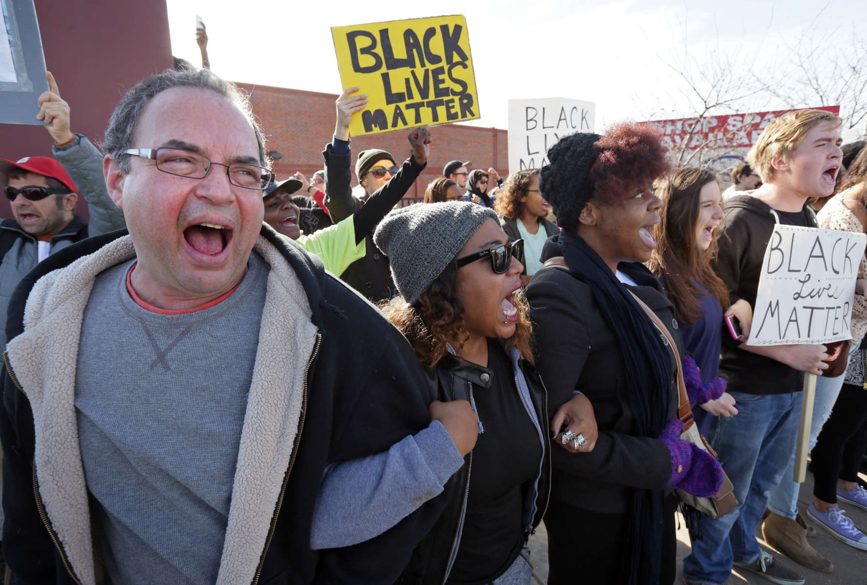 {quote}Black lives matter{quote} shout protesters Daniel Conford (left), Tracy Parks, Ashley Carter, Judy Lucas and Luke Davis(right) as they all link arms and face off to police at during a demonstration along Eager Road on Saturday, Nov. 29, 2014.Photo By David Carson, dcarson@post-dispatch.com